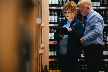 Liquor store workers taking stock