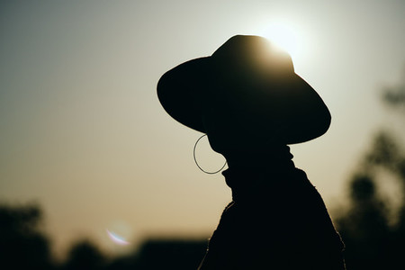 Silhouette of a woman with a hat