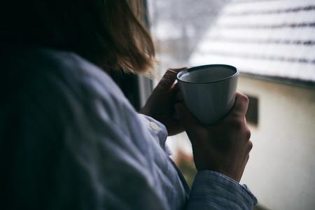 Woman drinking hot beberage