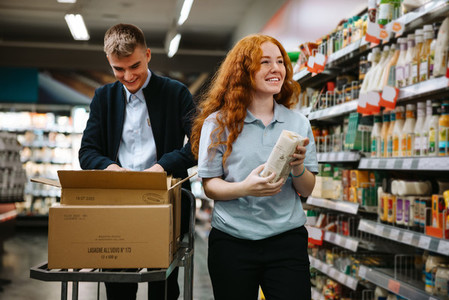 Young people on holiday job at supermarket