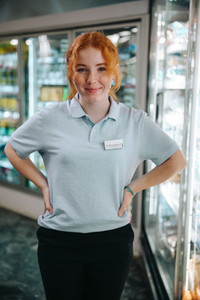 Young worker in supermarket