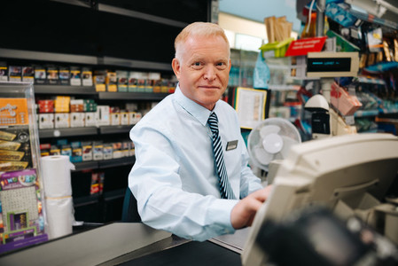 Supermarket store manager at cash register