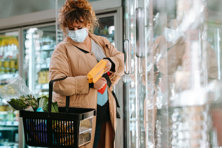 Woman shopping grocery during pandemic