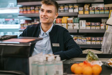 Man working at cash counter