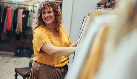 Friendly saleswoman in a boutique