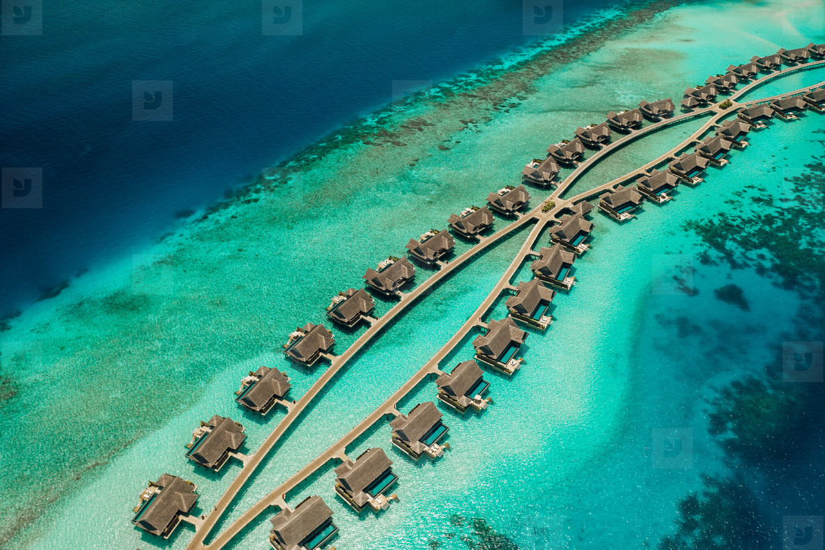 Aerial view of overwater villas at a luxury island