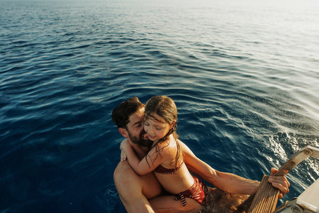 Father and daughter taking a swim in the sea during a vacation