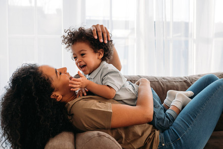 Mother playing with cute son