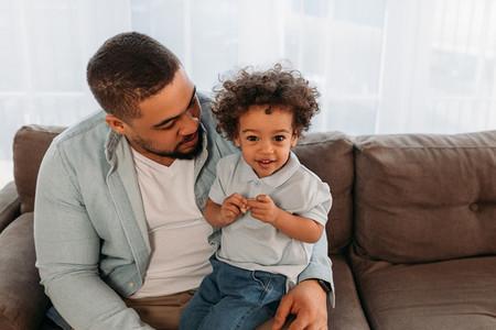 Little boy sitting on fathers