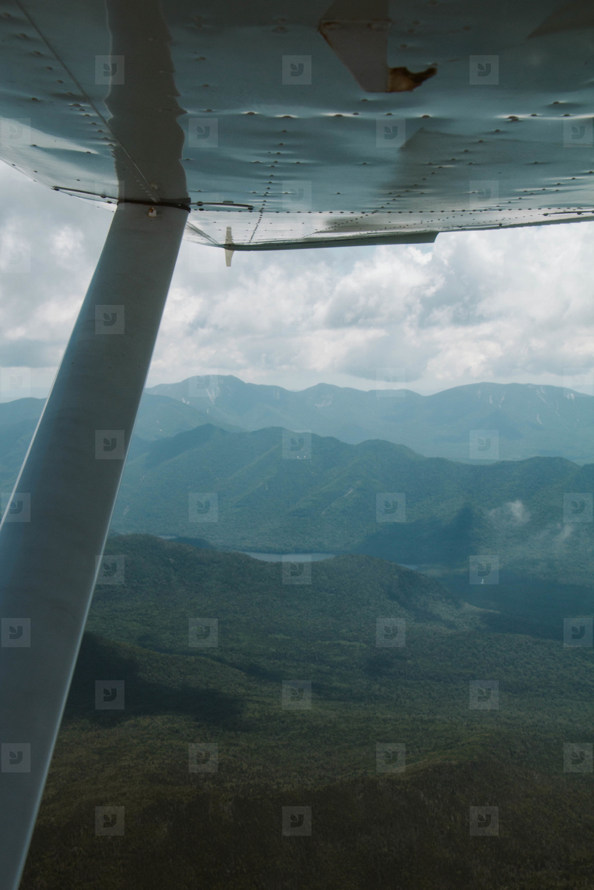 Airplane  clouds  and mountains