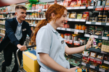 Supermarket employees having fun while working