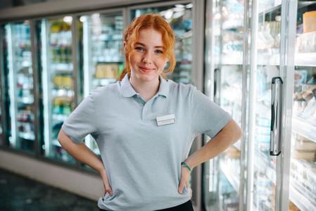 Woman on holiday job at supermarket