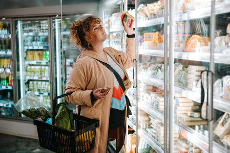 Woman shopping groceries in supermarket