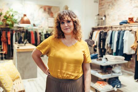 Confident fashion boutique owner
