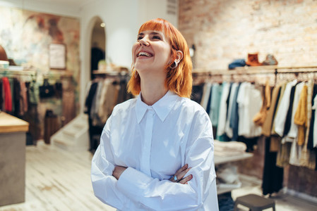 Fashion store owner smiling