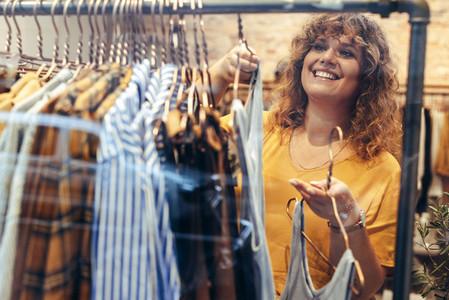 Customer choosing dress in store