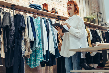 Shop owner with a digital tablet