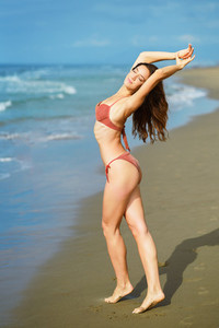 Portrait of a woman with beautiful body on a tropical beach