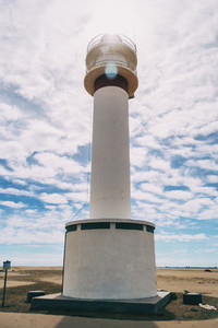 lighthouse on the lonely beach of delta del ebro tarragona spain