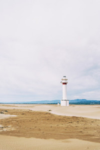 lighthouse on the lonely beach of delta del ebro tarragona spain