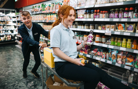 Grocery store employees having fun while working