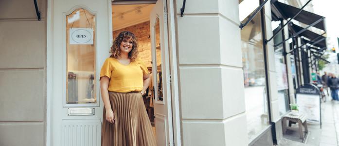 Beautiful woman running a fashion store