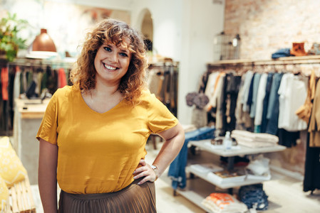 Woman standing in a fashion boutique