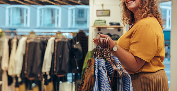 Woman working in clothing store