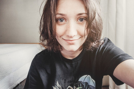 girl with short hair and blue eyes takes a selfie