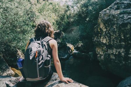 Girl sitting looking at the views of the Prades mountains  Tarragona