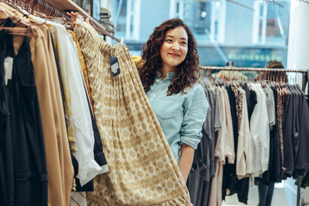 Clothing store owner assisting customer