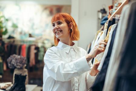 Woman enjoying shopping in fashion store