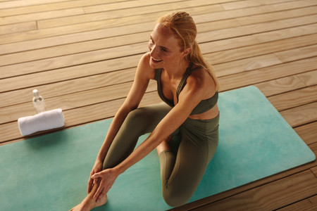 Woman relaxing during a fitness session