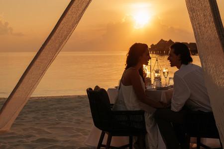 Romantic couple at sunset dinner