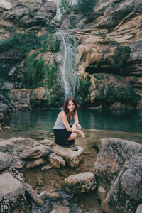 woman next to a waterfall