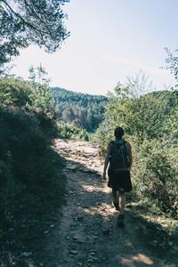woman walking along a small path