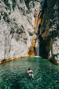 girl in the water in a waterfall in sadernes
