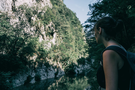Girl walking along a small path in the mountain of sadernes  Spain