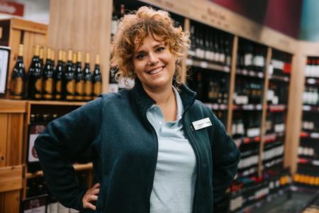Confident liquor store employee