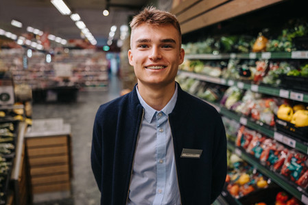 Young grocery store assistant