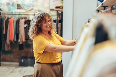 Happy woman working in a fashion store