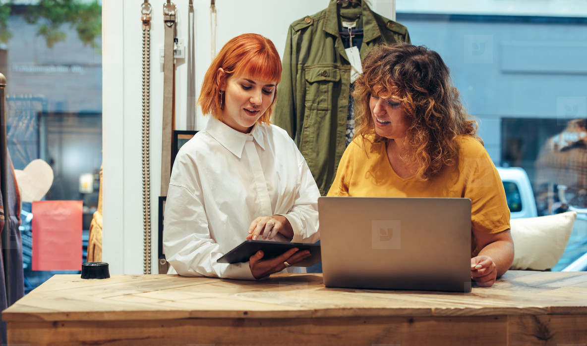 Two women running clothing store business
