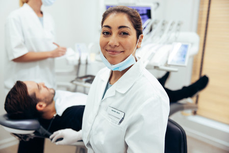 Happy female dentist in her clinic