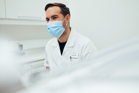 Dentist with a face mask at dentistry