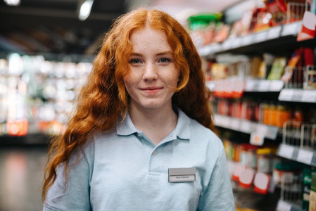 Young worker working in the grocery store