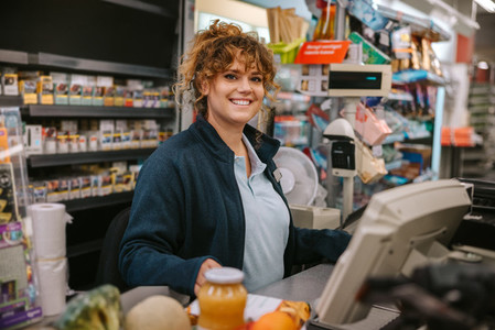 Supermarket cashier at checkout