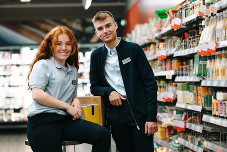 People on holiday job at local grocery store
