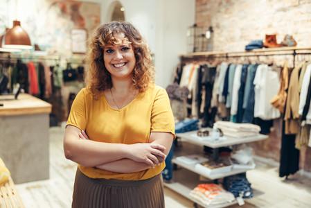 Happy fashion boutique owner