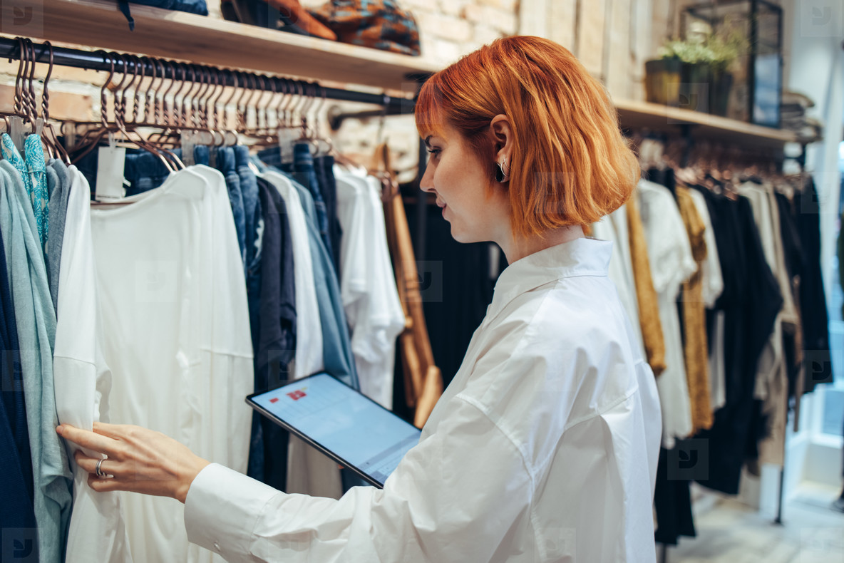 Woman taking inventory in clothing store