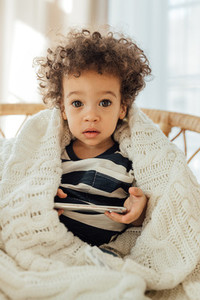 Portrait of a cute little boy with smartphone